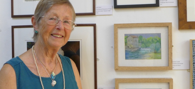 Caroline Coode by her work in the Friends Summer Exhibition 2019